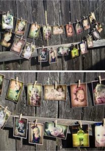 Photographs on pegs for a wedding anniversary decoration